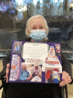 Residents at Watercrest Columbia Assisted Living and Memory Care are  sparking their creativity through Watercrest's signature programming, Artful Expressions.  Resident Linda Fisher proudly displays her 'Holidays Over the Years' canvas collage, showcasing her unique poetry and individual artwork created in a Watercrest creative writing workshop.