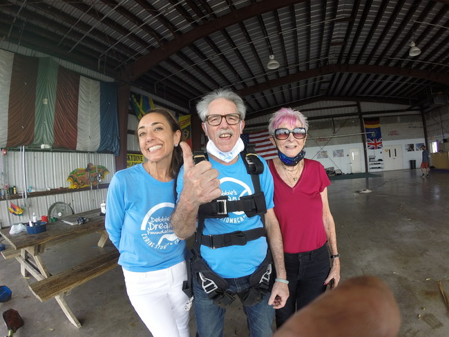 DDF Events Director Nicole Berngard, six-year stomach cancer survivor and recipient of the 2020 Dream Makers Miracle Fund skydiving adventure Kenny Rikard, and Toby Friedman, Kenny's mother, and caregiver.