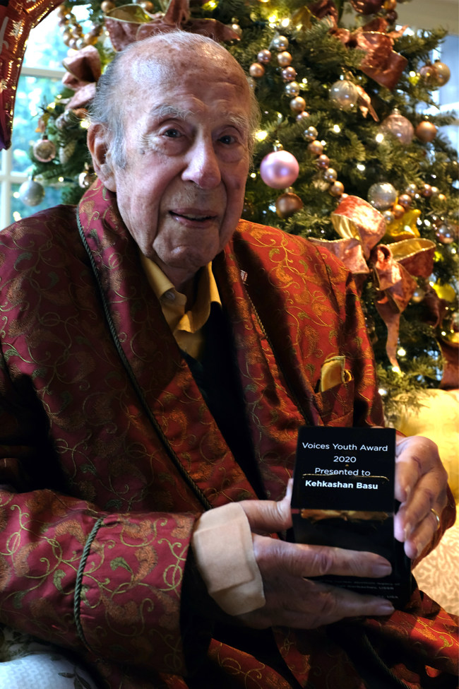 "Former US Secretary of State, George P. Shultz, holds the first ""Voices Youth Award"" named in his honor and also in honor of Mikhail Gorbachev, former president of the USSR. Photo Credit: David Fedor."