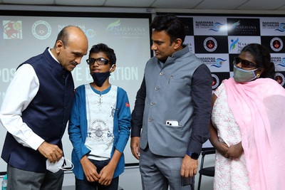 The doctor in action: Karnataka Health Minister Dr K Sudhakar checking on young boy's vision as Dr K Bhujang Shetty, CMD of Narayana Nethralaya looks on, during inauguration of National programme on eye donation awareness for health care professionals at Narayana Nethralaya on Saturday in Bengaluru.