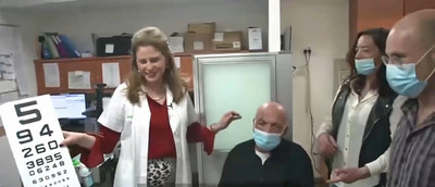 Prof. Irit Bahar and Dr. Gilad Litvin, together with the first-in-human KPro patient and his daughter, the moment his sight returned.