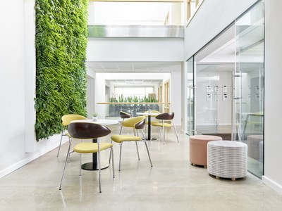 Natural light, biophilic design, and ergonomic seating are found across the campus and provide comfortable and bright work spaces with live natural elements including a two-story living green wall.