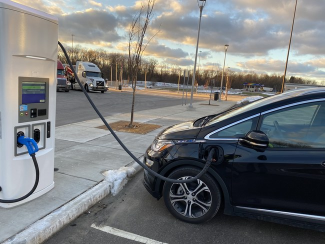 Chevy Bolt employee EV charging at Rolling Prairie Travel plaza.