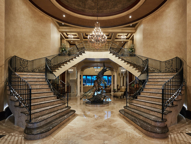 Grand Staircase Entry at 176 Spyglass Lane, Jupiter, Fl. Home includes a million dollar theater designed by an associate of George Lucas, an air conditioned 25 car garage with workshop and indoor parking for a motor coach, 365' of prime waterfront with space for a mega yacht, and much more !
