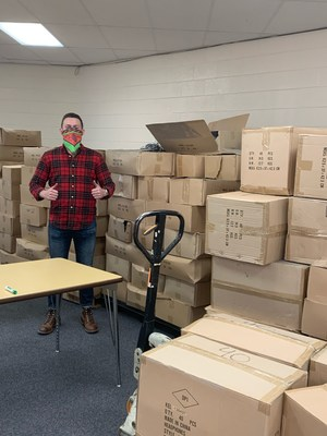 Kellyco's Purchasing Director, Nathan Barr, brings over $50,000 worth of audio equipment to Knox County for virtual-learning students.