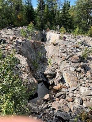 Photo 1: 80m long trench on the Rivard Property, looking back to the northwest along the strike of a gold-bearing vein (CNW Group/Trillium Gold Mines Inc.)