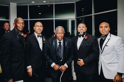 Pictured (L-R): Immediate Past Chairman of the 100 Black Men of Atlanta, Larry Johnson, Board Member, Sid Barron, Hank Aaron, Chairman Kevin Gooch, and former Executive Director Anthony Flynn