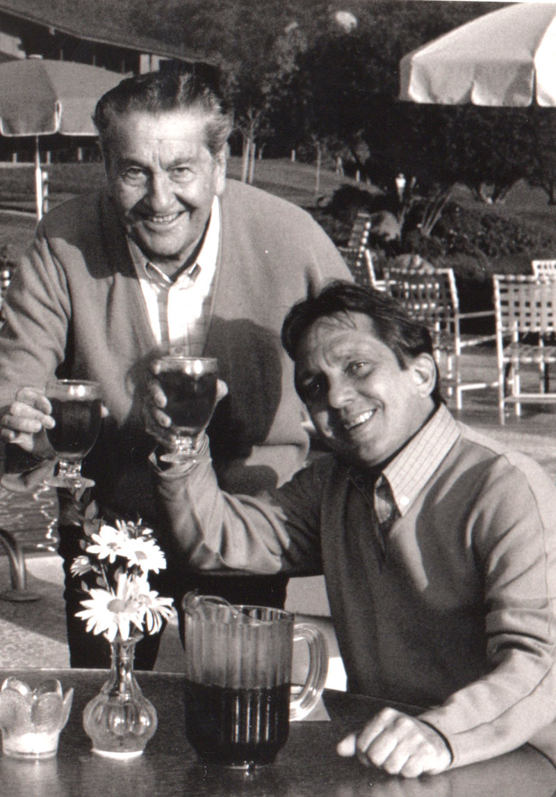 The late Lawrence Welk (standing) with son and current Welk Resorts' board Chair Larry Welk (seated).
