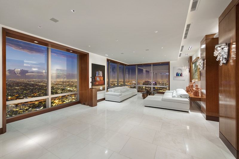 """More than $1 million was spent just on the penthouse's custom woodwork, some of which is on display in the living area (shown here). Woodwork was also used to """"frame"""" many of the large windows in the grand salon, as the owner wanted to present the residence's stunning views as """"works of art"""" seen through these frames. More at MiamiLuxuryAuction.com."""