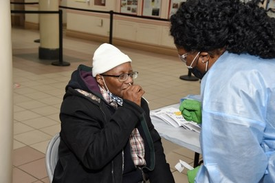 A community member is tested for COVID-19 at the Abyssinian Baptist Church in Harlem on Jan. 25. Hundreds of events like this one will take place in Black communities across the U.S., a partnership of Choose Healthy Life, Quest Diagnostics and the United Way.