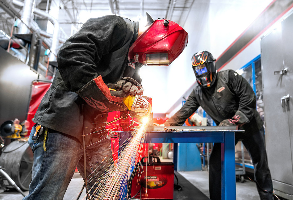 Two students in UTI's 36-week Welding Technology program train hands-on in real-life situations that prepare them for their careers.