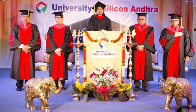 Jahanavi Chamarthi singing National Anthem Raju Chamarthi-Provost, Anand Kuchibhotla-President, Deenababu Kodubhatla-CFO, Dilip Kondiparti-Community Advisor (PRNewsfoto/University of Silicon Andhra)