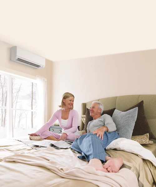 Couple stays warm and cozy in the winter with technology from Mitsubishi Electric Trane HVAC US
