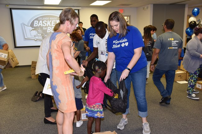 """The Magic and Florida Blue have a decade-long community partnership that most recently centered around the former Baskets for Books program and now will work to address the issue of hunger through the """"Block Out Hunger"""" program."""