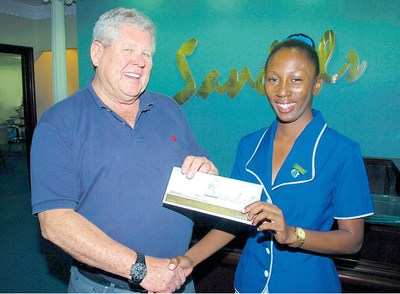 """The late Gordon """"Butch"""" Stewart presenting a team member with an opportunity to further her potential toward an even brighter future."""