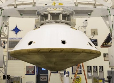 """Mars 2020 transport/entry aeroshell, the aft-body and TPS, being """"fit-up"""" checked.  The assembled aeroshell will carry the rover vehicle thru the Mars atmosphere for landing. A Mars touchdown is scheduled for February 2021. FMI, a subsidiary of Spirit AeroSystems, fabricated the thermal protection system for the Mars 2020 transport/entry aeroshell."""