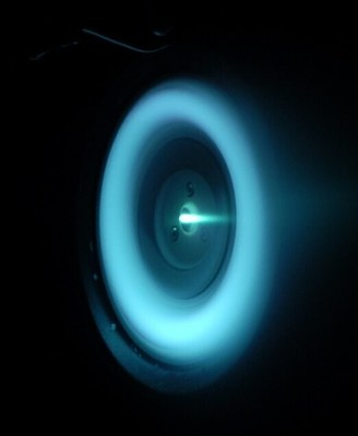 EOI's proprietary electric propulsion system glows blue during vacuum chamber testing at Air Force Research Lab's facility (SPEF) at Edwards AFB in December 2020.