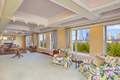 The condominium occupies one entire floor within an ultra-exclusive building in the Lenox Hill neighborhood of Manhattan's Upper East Side. Its sprawling great room (shown here) is 46 feet wide and surrounded by large windows with direct views over Central Park. NewYorkLuxuryAuction.com.