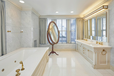 The master bath relies on bright marbles and stone with gilded fixtures and accents to create an elegant atmosphere in which one may prepare for, or wind down from, the day's affairs. NewYorkLuxuryAuction.com.