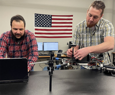 Berry Aviation's expansion into autonomous and unmanned aviation is creating job opportunities for highly-skilled labor in Oklahoma. Thomas Blem (L) and Aron Felder (R), both Oklahoma State University graduates, perform final checks on an American designed and manufactured drone at Berry Aviation's Stillwater integration shop. Photo courtesy of Berry Aviation, Inc.
