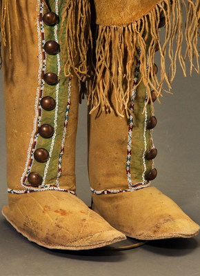On offer from Sherwoods Spirit of America at the Virtual American Indian Art Show/ San Francisco. These Comanche high top hide moccasins feature hand rubbed yellow ochre and green mineral pigment, large domed trade brass buttons, rolled over top cuffs with long fringe, and buffalo hide soles. They date back to the 19th century and are 17 1/2 inches by 9 1/2 inches.