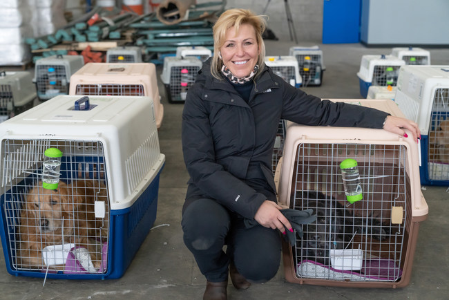 Jill Stewart, President & Founder of China Rescue Dogs, welcomes a flight of dogs into JFK airport in January.