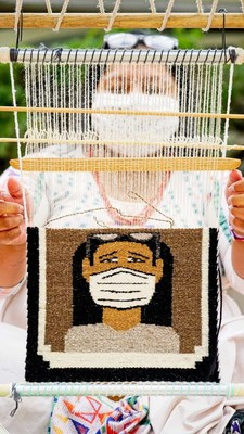 Pamela Brown, a recipient of BlessingWay's COVID relief, is at her loom weaving a pictorial Toadlena/Two Grey Hills rug of a Navajo wearing a face mask. Photo by Stephen Henderson & Metamorphosis The Art of Living