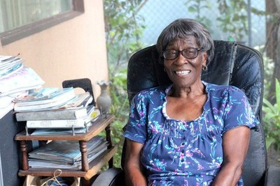 Annie Green, a resident of Town Center Apartments in Opa Locka, Fla., is happy to receive help from ChenMed and the city's Community Development Corporation to pay her utility bill.