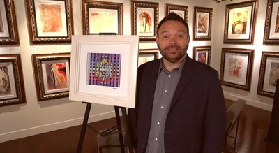 Park West Executive Vice President John Block presents artwork by Yaacov Agam and Salvador Dali at the Park West Fine Art Museum in Las Vegas.