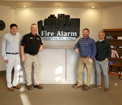 Left: Pye-Barker Fire CEO Bart Proctor with FAS Owner Shannon Smith Right: Pye-Barker Fire VP of Business Development Chuck Reimel and COO Joseph Hightower