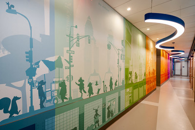 New York City-themed artwork lines the hallway of the consult and exam rooms. The playful panorama above, designed by illustrator John Skewes who created much of the artwork throughout Hassenfeld Children's Hospital—34th Street, depicts a cross section of busy Midtown Manhattan inhabited entirely by animals.