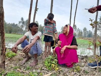 Smallholder farmer Sunita Devi (right) and her son (far left), Uttar Pradesh, India