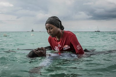 Photo by Anna Boyiazis. Swim instructor Siti, 24, helps a girl float on Nov. 17, 2016 in the Indian Ocean off of Nungwi, Zanzibar. From the long-term project, Finding Freedom in the Water.