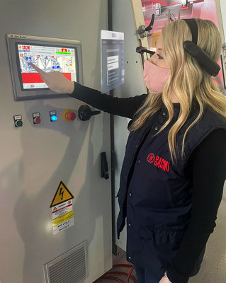 A SACMI USA Group operator follows a maintenance Work Order on her head-mounted tablet powered by SPACE1