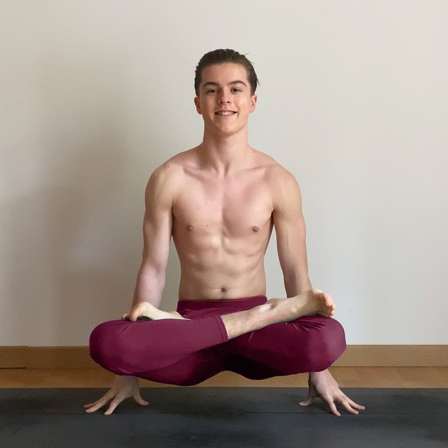 Jules thine a.k.a. julesyogi in scale pose or lifted lotus pose