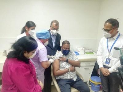 Mr. Mervin Vaiz (46) getting vaccination shot at Manipal Hospitals Old Airport Road