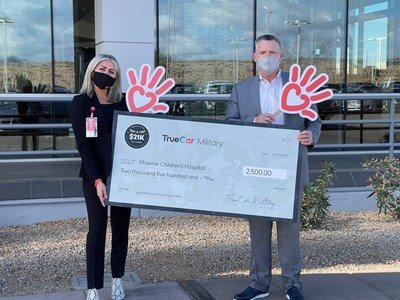 Check donation from AutoNation Ford Scottsdale and TrueCar to Phoenix Children's Hospital Foundation. From left to right: Warren Miller, General Manager of Scottsdale Ford, and Haley Chapman, Corporate Development Officer at Phoenix Children's Hospital Foundation