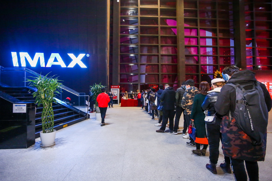 """Fans line up for an IMAX screening of """"Avatar"""" at the National Film Museum in Beijing"""