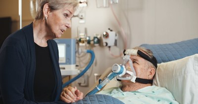 Patient using ReddyPort™ Microphone to communicate with family member.