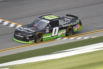 The ForeverLawn #BlackandGreenGrassMachine driven by Jeffrey Earnhardt on team JD Motorsports with Garry Keller during the 2021 NASCAR Xfinity Series season.