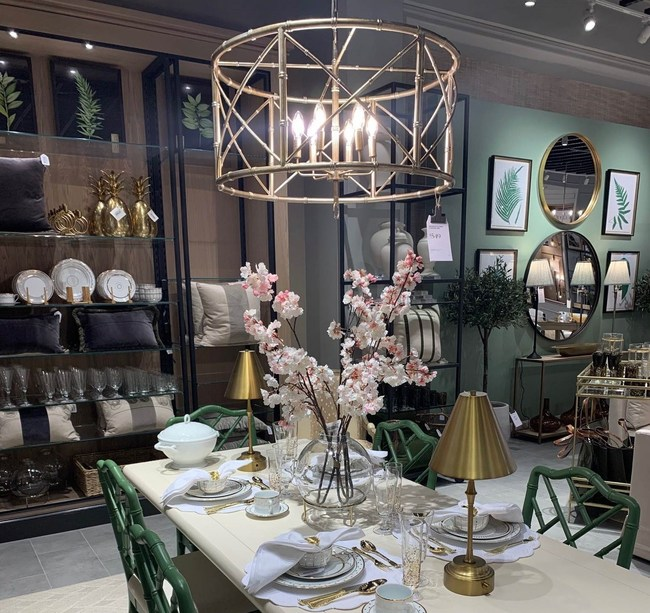 Figure 1 Ballard Designs dining room floor set for Houston store opening with spring 2021 Home Furniture & Decor product selection. The new retail store is now open in River Oaks!