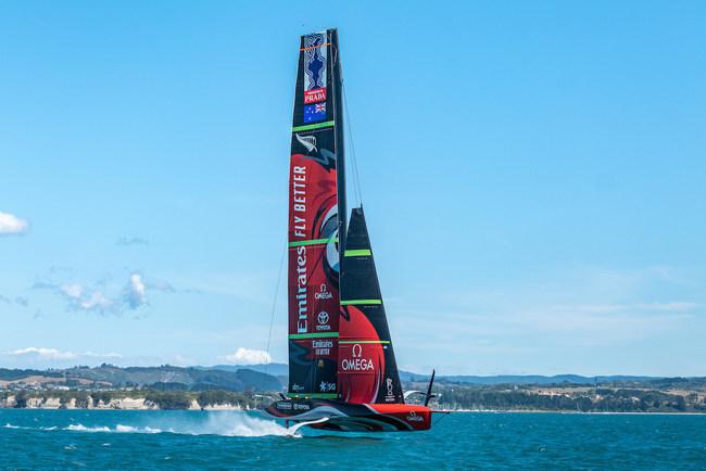 "Emirates Team New Zealand's yacht ""Te Rehutai"" flies just above the water. Photo courtesy of Emirates Team New Zealand."