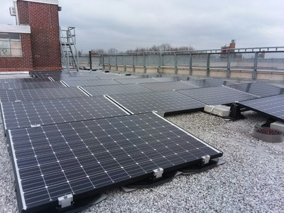 Workers have finished the installation of solar panels at NYCHA's Carver Houses development. Photo credit: Accord Power Inc.