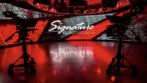 """Located in Chicago's western suburbs, the studio at Signature Production Group features a wraparound LED wall and Extended Reality (XR) capabilities.  SPG provides production technology (audio, video, lighting) for live meetings.  Additionally, they can produce up to ten simultaneous online (or """"virtual"""") events in their broadcast control rooms."""