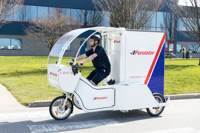 Purolator announced the launch of fully electric–cargo bikes (e-bikes) in Vancouver. (CNW Group/Purolator Inc.)