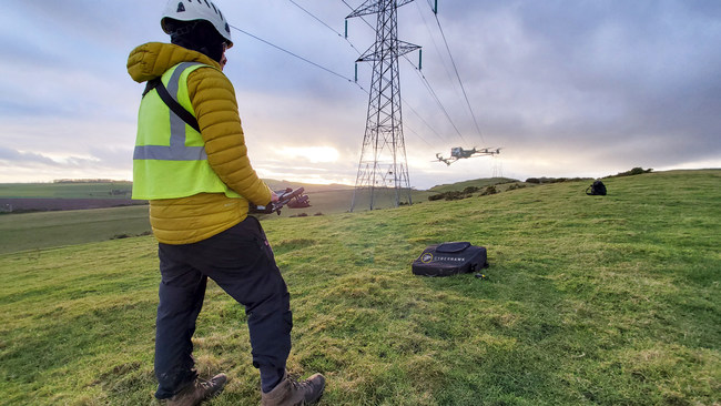 Cyberhawk pilot conducting drone inspection of SSEN Transmission's power grid.