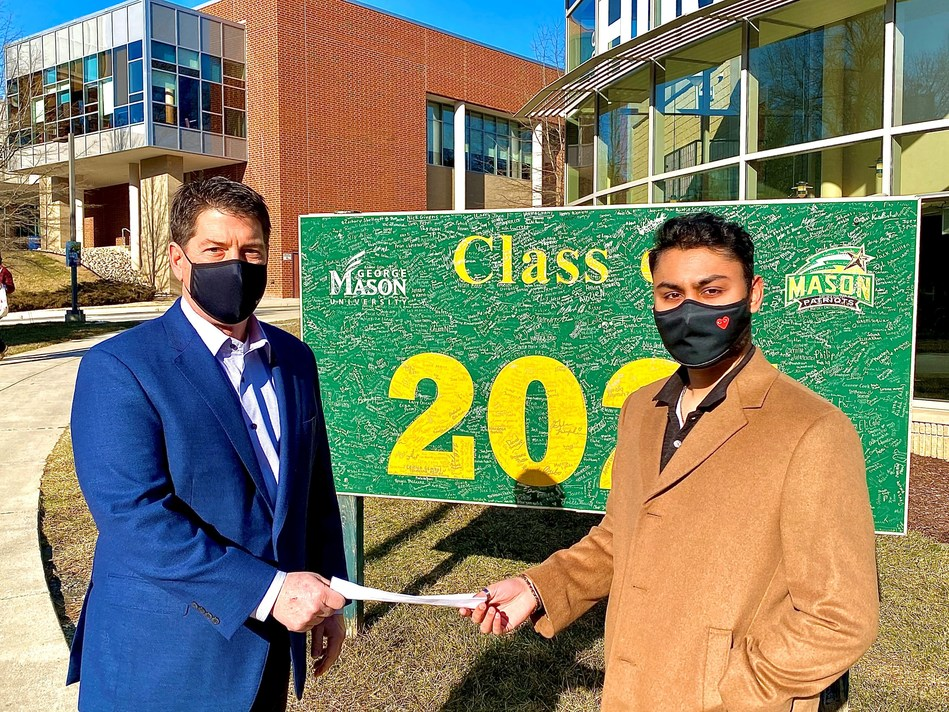 """Able CEO Steve Kuhn presents Mason Honors College Student Zain Jafri with a scholarship award on the university campus. Able considers the relationship with Mason a key part of its """"Alive and Able"""" Wellbeing Program. Bronze level support of Mason Career Services Partnership Program takes the relationship to the next step as a fourth scholarship is announced."""
