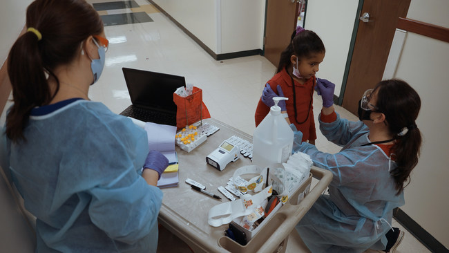 An elementary school student is receives a rapid antigen test using the BD Veritor™ Plus System for Rapid Detection of SARS-CoV-2.
