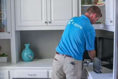 A C Spire Home technician installs fiber-based, ultra-fast Gigabit internet in a home. The company celebrated the addition of its most recent Alabama market with a news briefing at the home of one of its first customers in Trussville.