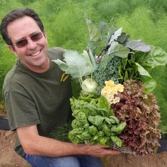 Farmer Joe holding a May farm share